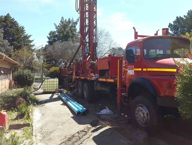 Drilling of borehole at school in Atlantis.