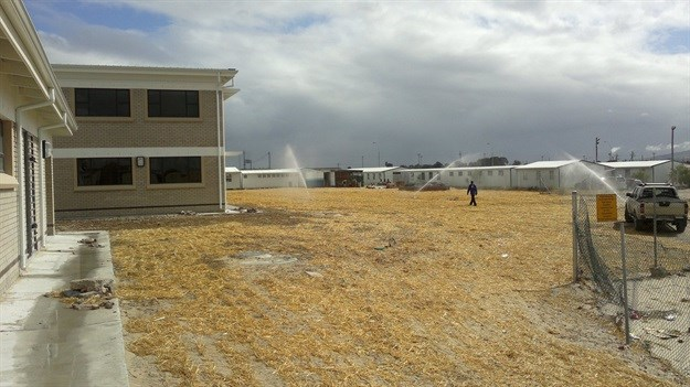 Irrigation of newly seeded sports filed at school in Delft.