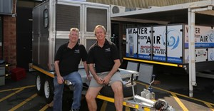 Water from Air technical director, Paul Raglan-Smith and CEO Ray de Vries with a mobile 1,500 litres per day machine designed and manufactured in South Africa.