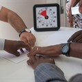 A Unicef team creating a collaborative paper plane. (Unicef)