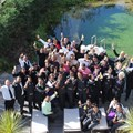 Hotel Verde staff celebrating the good news of FTT accreditation at the eco pool