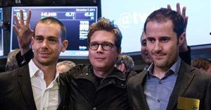 Twitter co-founder Biz Stone, at center in 2013 photo at the New York Stock Exchange debut of the social network, is flanked by co-founders Jack Dorsey, at left, and Ev Williams. Stone is returning to work at Twitter after a six-year hiatus |