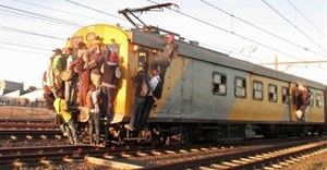 Commuters climbing on a Khayelitsha-bound train. Photo by Mandla Mnyakama