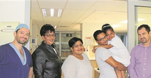 After a successful cochlear implant, Aloshay Arendse (8) is getting a second chance at childhood. With her from left are anaesthetist Dr Nick Meyersfeld, her grandmother Spasina Isaacs, mother Candice Isaacs, father Ashley Arendse and Dr Gary Kroukamp, one of her surgeons, at Life Kingsbury Hospital. Photo: People's Post
