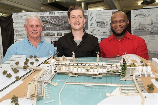 Jean-Pierre Desuaux De Marginy holding a model of his winning design with Allin Dangers (left) director of sales, KZN & Border and Lawrence Ogunsanya (right), head of the Department of Architecture at UKZN.