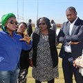 Tourism Deputy Minister Elizabeth Thebethe, Deputy Minister of the Presidency Buti Manamela and North West Tourism MEC Desbo Mohono engaging with one of the exhibitors at the Youth in Tourism Imbizo