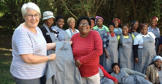 Adéle's Mohair near Fish River Mouth has been providing employment for rural communities for over 30 years. Here founder and Agri EC Adéle Cutten (left) and long-time employee Liz Dyakala (right) inspect the team's new uniforms. (Image: Supplied)