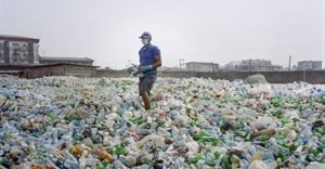 A man sorting a sea of plastic bottles at one of the Wecycler hubs in Lagos, Nigeria. Most plastic litter from cities ends up in oceans. Photo: Panos/Joan Bardeletti