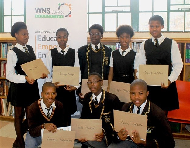 Masiphatisane Senior Secondary Students receive their graduation certificates.