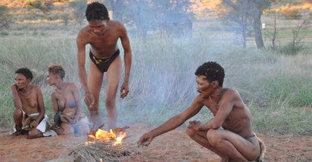 Khomani San men and women around the fire