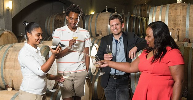 From left to right: Gynore Fredericks (first year protégé under mentorship of Miles Mossop at Tokara), Sydney Mello (second year protégé under mentorship of Johan Malan at Simonsig), Tobie Badenhorst (Head of Group Sponsorships and Cause Marketing at Nedbank Ltd), Becky Penumlungu (Sponsorship Manager of Lifestyle Properties at Nedbank Ltd)