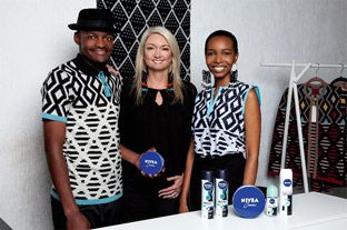 (L-R) Laduma Ngxokolo, Samantha Geyle, Nivea Marketing Manager and Mpho Ntlatleng, who is wearing the Maxhosa T-shirt which can be won.