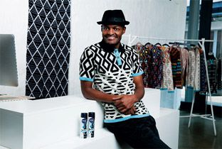 Laduma Ngxokolo with Maxhosa creations in the background.