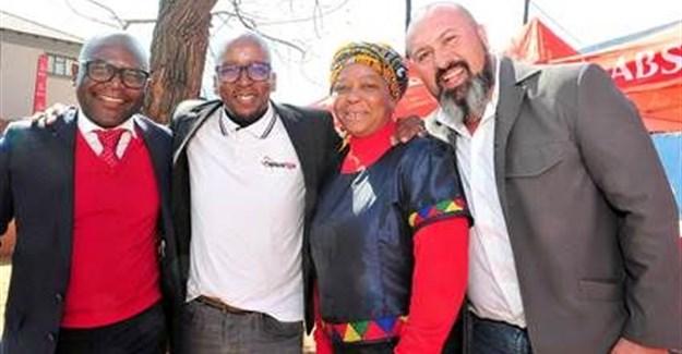 Oscar Siziba, Absa managing executive in Limpopo, Mpumalanga, Pretoria; Tshepo Seeta, eSpaza Sum managing director and founder; Anastasia Mathabathe, spaza owner and Tony Ferreira, operations director, Big Save.