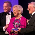 May de Lencquesaing holding her IWC Lifetime Achievement Award, flanked by Tim Atkin (left) and Charles Metcalfe (right)