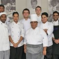 Judges with Candidate Chefs in Cape Town. From left to right: Capsicum Culinary Studio's Julietta e Silva, Megan Angus (Woodview Wagyu & Angus Beef), Craig Cormack (Celebrity Chef), Marieta Human (Hospitality Consultant), and Chief Judge Heinz Brunner (Honorary President of the South African Chefs Association, past Vice-Chairman of the World Body of Chefs and team manager of the Culinary Olympics team)