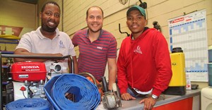 Co-owners of Majozi Brothers Construction Sihle Ndlela (left) and Simphiwe Majozi (right) celebrate the launch of Majozi Bros Tool Hire & Sales with Hire-It Natal's Richard Fraser.