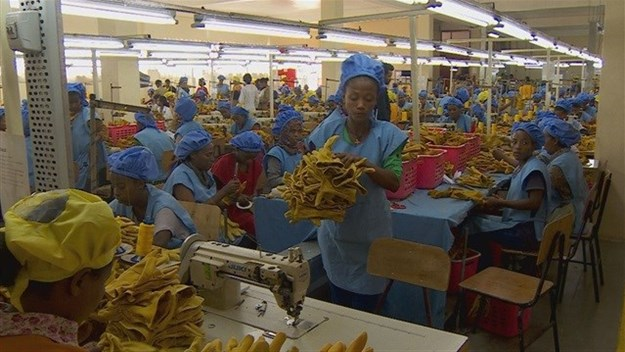Ethiopia is betting on industrialisation to put millions of its people to work, here at the Pittards factory in Addis Ababa, workers make leather gloves for sale in America. Credit: BBC.