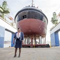 Lady Sponsor of the Usiba tug, Judith Nzimande, with the new tug which will serve at the Port of Richards Bay.