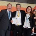 Peninsula GM Chris Godenir receiving THINC award