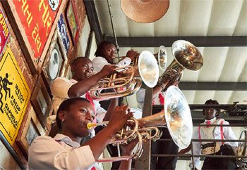 A large-scale field band will perform at the race
