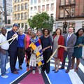 Esther Mahlangu cuts the ribbon to officially open the mural to the public