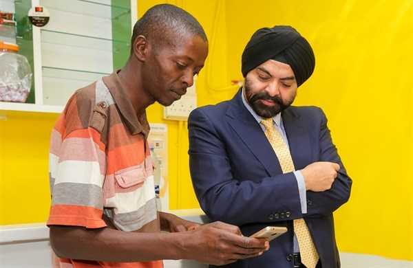 Mastercard president and CEO Ajay Banga visited Paul Makeleke, owner of Kasi Convenience Food and Internet Café in Alexandra, Johannesburg to see how the Spazapp is working for him.