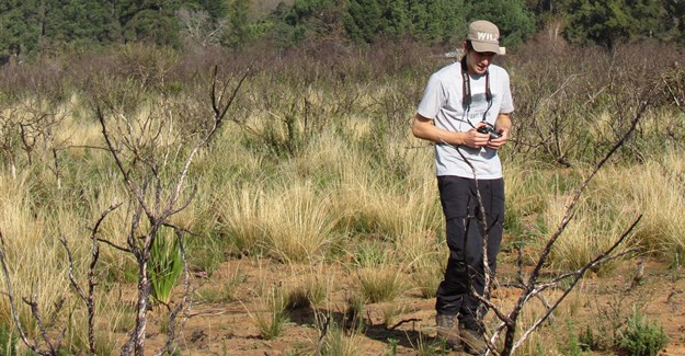 Stellenbosch University student Alistair Galloway on one of his field trips during the course of his research work. (Image Supplied)