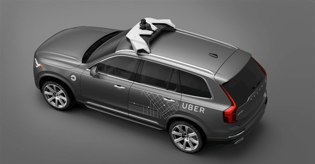Uber signs deal with Volvo in bid to build autonomous taxi fleet