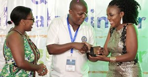 (L-R) Irene Mwathi, P&G's Communications Manager and David Buchere, KPAs Senior Communications Manager, present the award for Best PR Agency to Michelle Anekeya of Hill+Knowlton Strategies, during the 2017 PRSK Awards Gala in Mombasa.