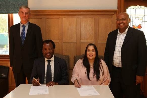 Professor Zeblon Vilakazi, Deputy Vice Chancellor at Wits University, sits together with Raakshani Sing, Executive Manager at CHIETA during the signing ceremony of Africa's first Energy Leadership Centre (ELC), officially launched at the Wits Business School. They are flanked by Dr Rod Crompton, newly-appointed Director of the ELC (on the left) and Maurice Radebe, Deputy Vice President: Energy and Sustainability at Sasol (on the right). <br>Picture credit: Debbie Yazbek