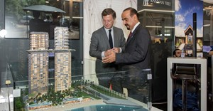 Nakheel Chairman Ali Rashid Lootah (right) and Sébastien Bazin, Chairman and CEO of AccorHotels with a scale of PALM360 on show at the International Luxury Travel Market (ILTM) in Cannes, France.