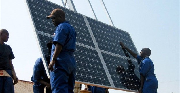 Training workers to properly install solar panels at health clinics in Rwanda provides clean energy and creates green jobs. Photo: Walt Ratterman, Sunepi