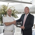 James Vos and the captain of The Crystal Symphony (Image Supplied)