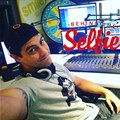 "Strydom captions this: ""Chilling out in the Smile 90.4FM studios!"""