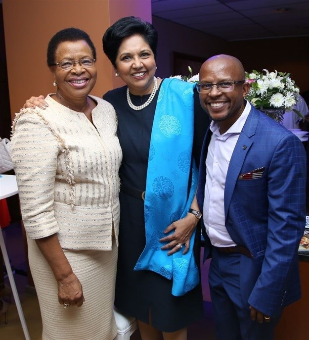 L-R: Graca Machel, Indra Nooyi, chairwoman and CEO of PepsiCo, and Sello Hatang, chief executive of the Nelson Mandela Foundation