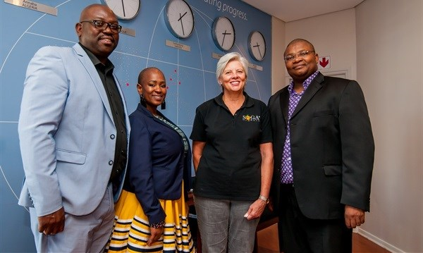 Nelson Mandela Bay Business Chamber's operations manager Prince Matonsi (left) and ECDC's senior manager for export promotion, Phakamisa George (far right), pictured with two companies enrolled on the Exporter Development Programme: Buzwebethu Textile Prints CEO Nobuzwe Mabona and SOGA Organic admin and logistics manager Diana Hannah.