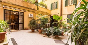 Colosseum Vacation Home in Rome, Italy - Level access is via a pretty courtyard which leads into the spacious, newly modernised home, with one bedroom and bathroom that have been specifically converted for guests with a disability or mobility issue. Source: