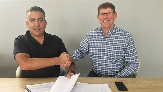 Alexi Romano (left), managing director of Romano Signs, with Sean Rogers, managing director of PSA, signing the merger agreement to create the largest corporate signage company in sub-Saharan Africa.
