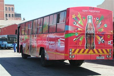 Tractor and Coca Cola launch bus campaign