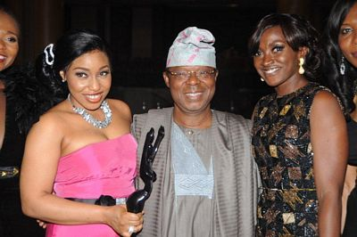 Chairman of Airtel Nigeria, Dr. Oba Otudeko (CFR) flanked by the winner of the Best Actress in the leading Role award, Rita Dominic (left) and actress, Kate Henshaw.
