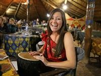 A guest enjoys the interactive drumming at The Boma - Dinner & Drum Show