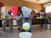 Soul Ambassadors wash and chop cabbages